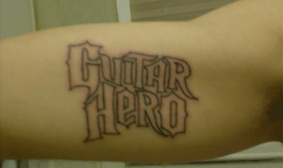 Timeless chick-magnet Guitar Hero tattoo photo