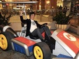 Miyamoto in a life-sized Mario Kart makes my day photo