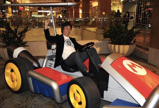 Miyamoto in a life-sized Mario Kart makes my day screenshot