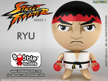 Cute bobbles of Street Fighter stars and SFxT producers photo