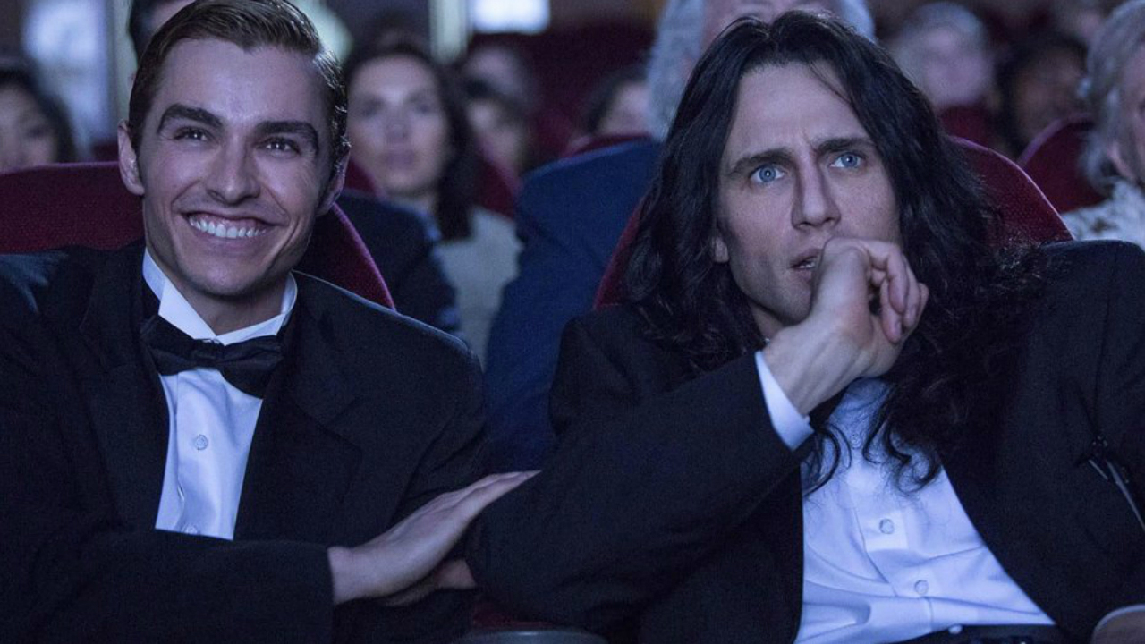 Dave and James Franco play brotherly grabass with Seth Rogen in The Disaster Artist, the story behind the worst movie ever, The Room.