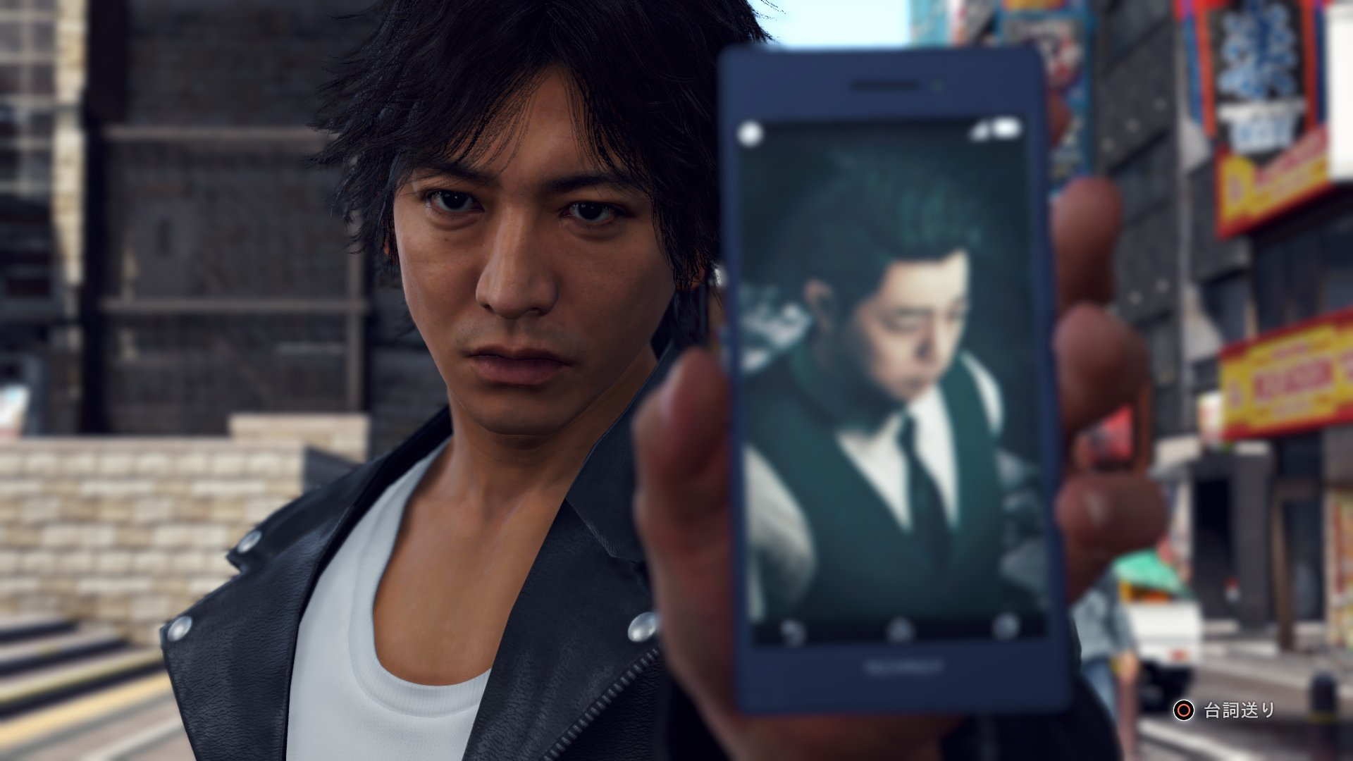 Yagami holding up a phone in Judgment