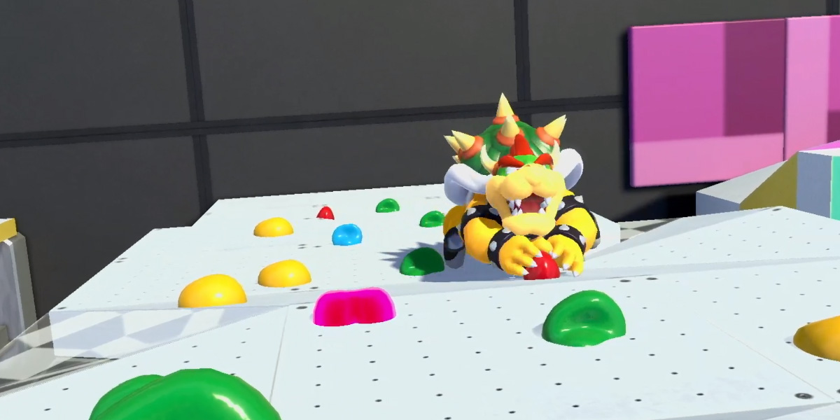 Here's Bowser climbing a rock wall in the Olympics screenshot