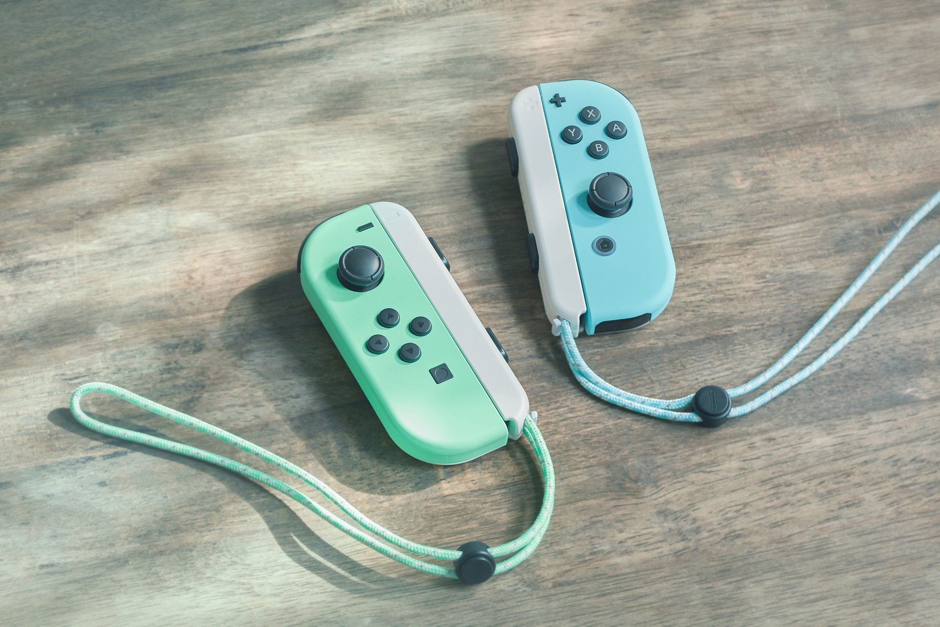 Pastel green and blue Joy-Con controllers.