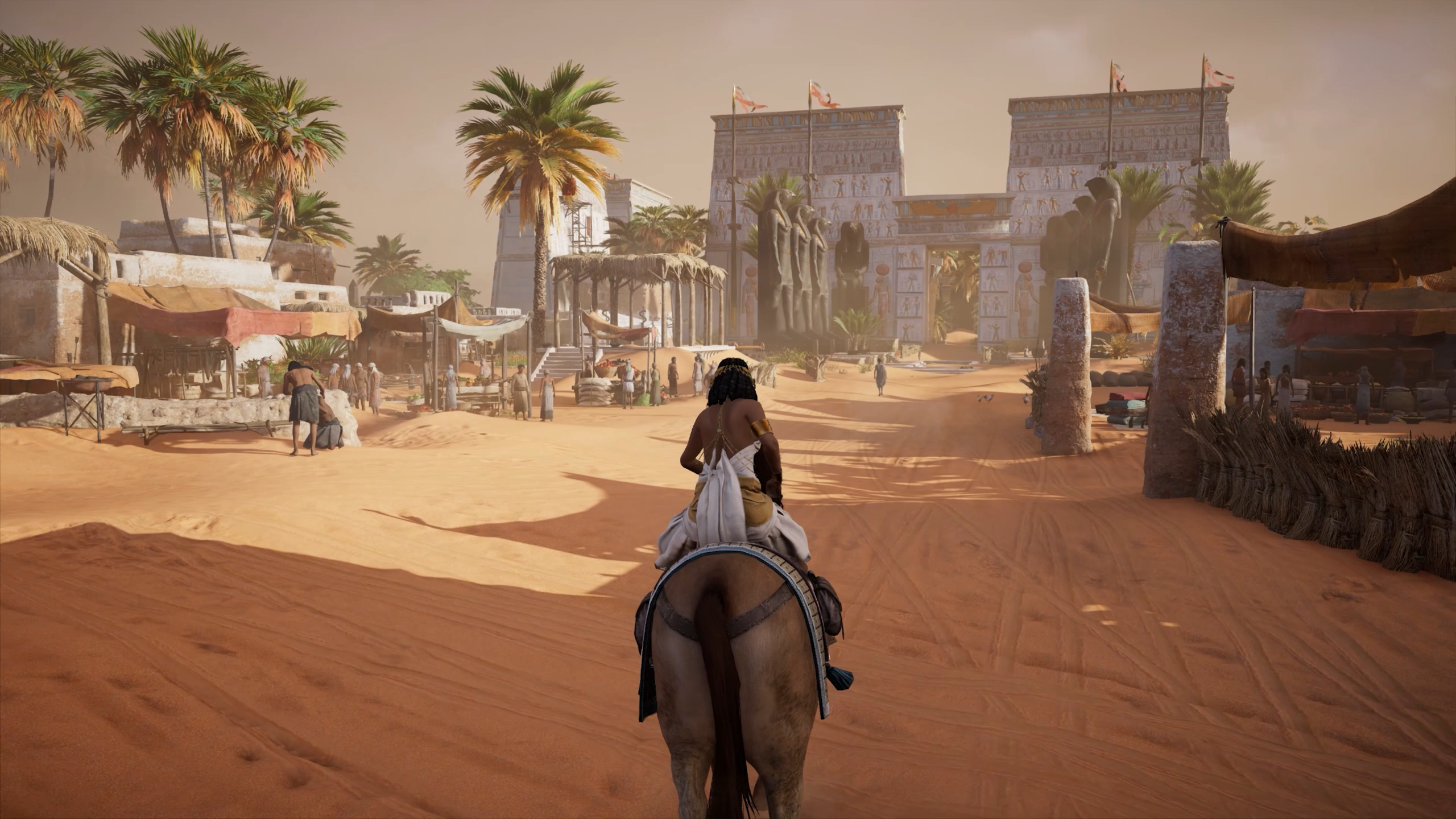 Riding through the sandy seas of Egypt in Assassin's Creed Origins screenshot