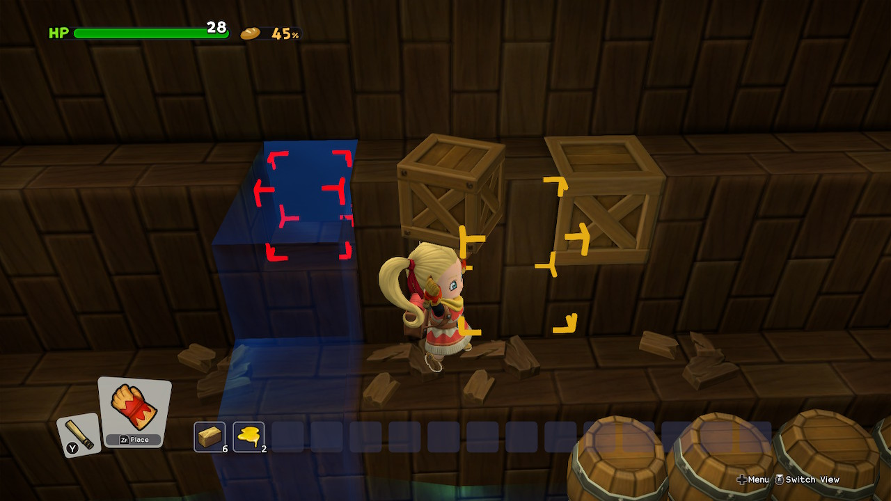 A main character holds a box and a red visual indicator shows where to put it.